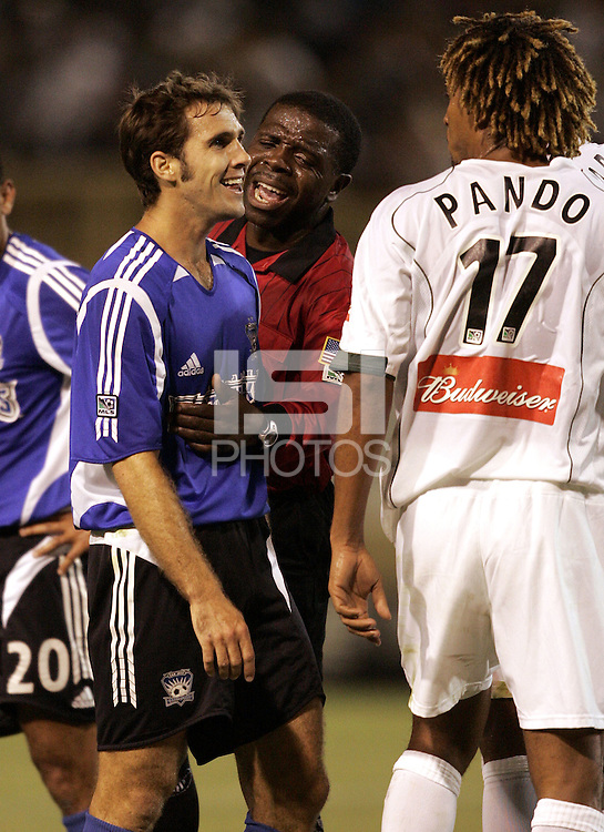 27 August 2005: Abiodun Okulaja, referee, tries to break an argument between Brian Mullan of the Earthquakes and Guillermo Ramirez of the Galaxy during the second half of the game at Spartan Stadium in San Jose, California.   Earthquakes defeated Galaxy, 2-1.