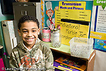 Education Elementary school Grade 2 motivational marble jar when teacher has cause to complient the class 2 marbles go into the jar horizontal male student smiling in front of jar display