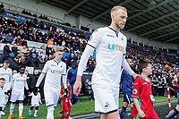 Mike van der Hoorn of Swansea with Swansea child mascot prior to kick off of the Fly Emirates FA Cup Quarter Final match between Swansea City and Tottenham Hotspur at the Liberty Stadium, Swansea, Wales, UK. Saturday 17 March 2018