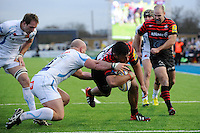 20130216 Copyright onEdition 2013©.Free for editorial use image, please credit: onEdition..Mako Vunipola of Saracens forces his way past Jack Yeandle of Exeter Chiefs to score his second try during the Premiership Rugby match between Saracens and Exeter Chiefs at Allianz Park on Saturday 16th February 2013 (Photo by Rob Munro)..For press contacts contact: Sam Feasey at brandRapport on M: +44 (0)7717 757114 E: SFeasey@brand-rapport.com..If you require a higher resolution image or you have any other onEdition photographic enquiries, please contact onEdition on 0845 900 2 900 or email info@onEdition.com.This image is copyright onEdition 2013©..This image has been supplied by onEdition and must be credited onEdition. The author is asserting his full Moral rights in relation to the publication of this image. Rights for onward transmission of any image or file is not granted or implied. Changing or deleting Copyright information is illegal as specified in the Copyright, Design and Patents Act 1988. If you are in any way unsure of your right to publish this image please contact onEdition on 0845 900 2 900 or email info@onEdition.com