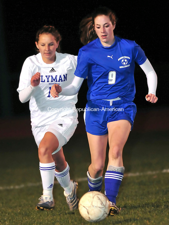 LEBANON, CT- 10 NOVEMBER 2008 --111008JS02--Nonnewaug's Gretchen Wortman (9) pushes the ball past Lyman Memorial's Caitlyn Walsh (18) during their Class M quarterfinal's Monday at Lyman Memorial High School in Lebanon. <br /> Jim Shannon / Republican-American