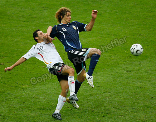Jun 30, 2006; Berlin, GERMANY; Germany forward (10) Oliver Neuville and Argentina defender (4) Fabricio Coloccini challenge for the ball during extra time in quarterfinal action of the 2006 FIFA World Cup at Olympiastadion, Berlin. Germany defeated Argentina 4-2 on penalty shots following a 1-1 draw after extra time. Mandatory Credit: Ron Scheffler-US PRESSWIRE Copyright © Ron Scheffler.