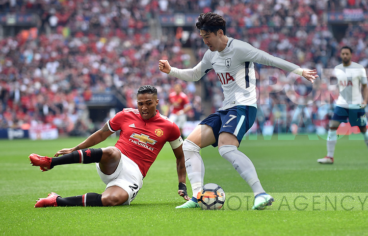 Son Heung-Min of Tottenham Hotspur is challenged by Luis Antonio Valencia of Manchester United during the FA cup semi-final match at Wembley Stadium, London. Picture date 21st April, 2018. Picture credit should read: Robin Parker/Sportimage