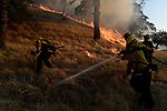 Winters, California, U.S. - A Cal Fire crew created a backfire to stop the growth of of the Quail Fire Saturday afternoon in Solano County California.