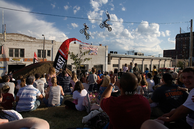 Crowds watch a dirt bike jump performance at Evel Knievel Days in Butte, MT, USA.