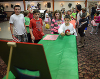 DJ O'Connor plays a game with friends at his Birthday party Wednesday October 14, 2015 at Twining Hall in Bensalem, Pennsylvania.  (Photo by William Thomas Cain)