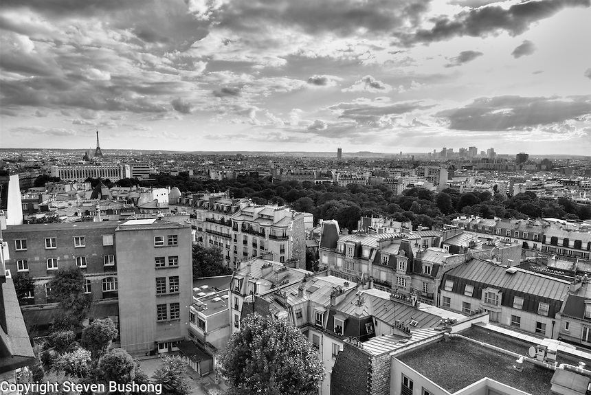 High Dynamic Range Black and  White landscape/panorama from a private terrace in Montmartre, Paris.  Shot compiled from bracketing three exposures.Eiffle Tower, Arc de Triomphe, Parisian rooftops and more are visible.  HDR realized in Photomatrix.