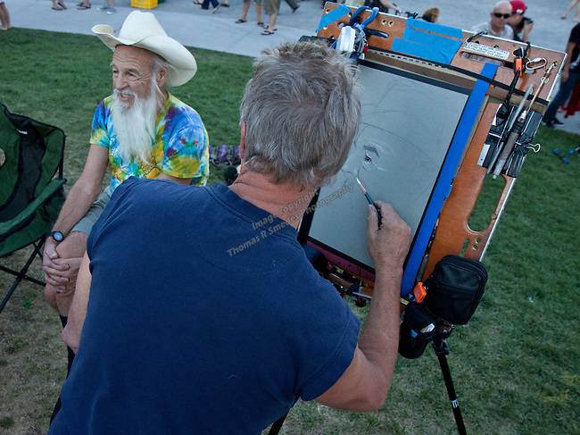 Bob Woerner poses for sketch artist David Tscheekar before the Maceo Parker performance during Artown's closing night on Tuesday, July 31, 2012 in Wingfield Park in Reno, Nevada.