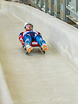 5 December 2014: Victor Kneyb, sliding for Russia, crosses the finish line on his first run, ending the day with a 9th place finish and a combined 2-run time of 1:43.656 in the Men's Competition at the Viessmann Luge World Cup, at the Olympic Sports Track in Lake Placid, New York, USA. Mandatory Credit: Ed Wolfstein Photo *** RAW (NEF) Image File Available ***