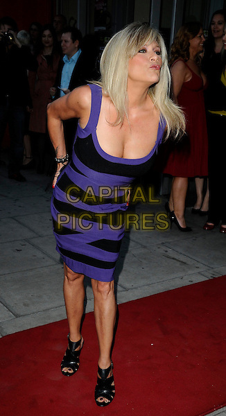 "SAMANTHA FOX .At the ""City Rats"" East End Film Festival VIP Screening, Genesis Cinema, Mile End Road, London, England, UK, .April 24th 2009..full length black and purple dress hand on hip booties sandals shoes leaning over cleavage .CAP/CAN.©Can Nguyen/Capital Pictures"