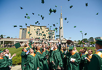 Graduates throw the caps in the air after Lansdale Catholic's graduation ceremonies Tuesday June 7, 2016at Our Lady of Czestochowa in Doylestown, Pennsylvania. (Photo by William Thomas Cain)