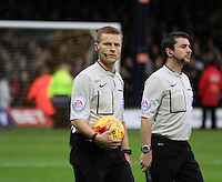 Premier League referee Mike Jones leads the two teams out before the Sky Bet League 2 match between Luton Town and Northampton Town at Kenilworth Road, Luton, England on 12 December 2015. Photo by Liam Smith/Prime Media Images.