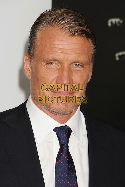 Dolph Lundgren.'The Expendables 2' premiere held at The Grauman's Chinese Theatre, Hollywood, California, USA..15th August 2012.headshot portrait stubble facial hair black suit white shirt blue tie .CAP/ROT/TM.©Tony Michaels/Roth Stock/Capital Pictures