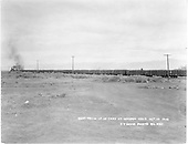 Distant view of D&amp;RGW northbound beet train at Hooper on the Valley Line.<br /> D&amp;RGW  Hooper, CO  Taken by Davis, O. T. - 10/25/1928