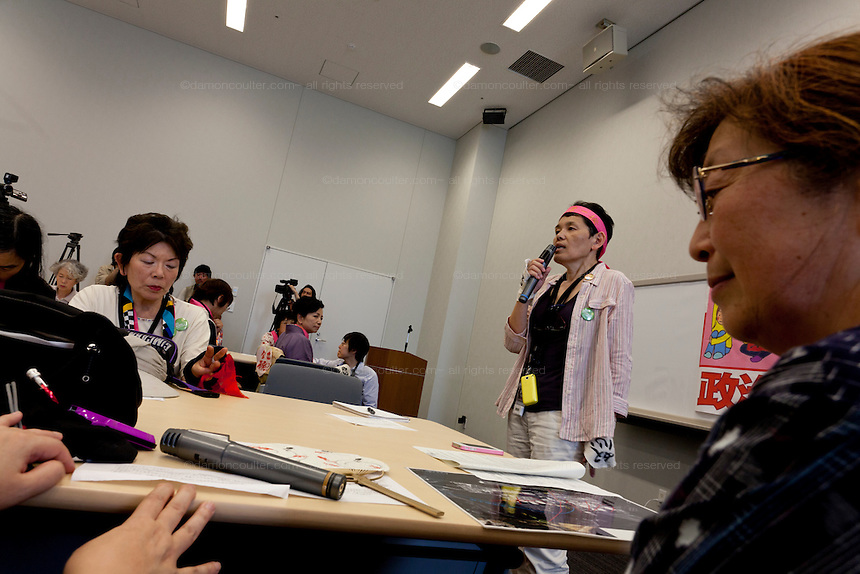 An anti nuclear activist speaking in the Member's Office Building of the House of Councillors in Tokyo, Japan. Friday June 29th 2012. About 400 protesters campaigned the restarting of the Oi nuclear power-station and the policy of Prime-Minister Noda to restart Japan's nuclear power generation programme which has been stalled since the earthquake and tsunami of March 11th 2011 caused meltdown and radiation leaks at the Fukushima Daichi Nuclear power-plant.