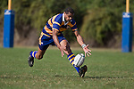 Simione Saravanua reaches to catch the bouncing ball during the CMRFU Counties Power Premier Club Rugby game between Patumahoe & Pukekohe played at Patumahoe on April 12th, 2008..The halftime score was 10 all with Pukekohe going on to win 23 - 18.
