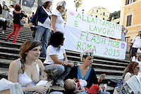 Roma, 3 Ottobre 2015<br /> Mamme allattano al seno in un flash mob a Piazza di Spagna durante la settimana mondiale per promuovere e difendere l'allattamento al seno.<br /> Allattamento e lavoro, con cappello da muratore.<br /> L'iniziativa &egrave; promossa da MAMI, Movimento Allattamento Materno Italiano<br /> Flash mob with breastfeeding collective to promote breastfeeding.