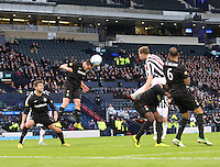 Scott Brown heads clear in the St Mirren v Celtic Scottish Communities League Cup Semi Final match played at Hampden Park, Glasgow on 27.1.13.