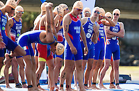 25 JUN 2011 - PONTEVEDRA, ESP - Jonathan Brownlee (GBR) (leaning forward) and Alistair Brownlee (GBR) (far right) look along the line of competitors before the start of the Elite Men's European Triathlon Championships in Pontevedra, Spain .(PHOTO (C) NIGEL FARROW)