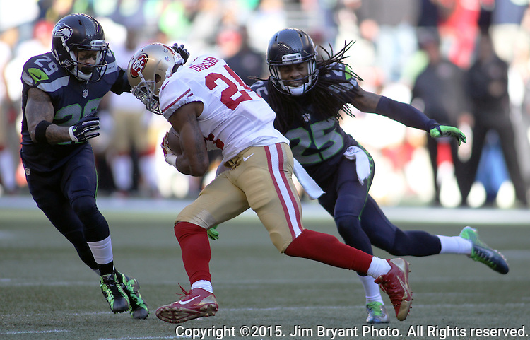Seattle Seahawks free safety Earl Thomas (29) and cornerback Richard Sherman closes in on San Francisco 49ers running back Shaun Draughn (24) at CenturyLink Field in Seattle, Washington on November 22, 2015.  The Seahawks beat the 49ers 29-13.   ©2015. Jim Bryant Photo. All RIghts Reserved.