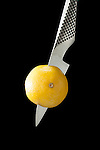 Global Paring Knife with lemon using Low Key Lighting
