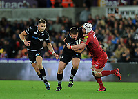 Ospreys' Scott Otten is tackled by Scarlets' Will Boyde<br /> <br /> Photographer Ashley Crowden/CameraSport<br /> <br /> Guinness Pro14 Round 6 - Ospreys v Scarlets - Saturday 7th October 2017 - Liberty Stadium - Swansea<br /> <br /> World Copyright &copy; 2017 CameraSport. All rights reserved. 43 Linden Ave. Countesthorpe. Leicester. England. LE8 5PG - Tel: +44 (0) 116 277 4147 - admin@camerasport.com - www.camerasport.com