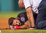 28 April 2017: Washington Nationals outfielder Adam Eaton lies in pain when injuring his ankle crossing first base after connecting for an infield single in the 9th inning against the New York Mets at Nationals Park in Washington, DC. The Mets defeated the Nationals 7-5 to take the first game of their 3-game weekend series. Mandatory Credit: Ed Wolfstein Photo *** RAW (NEF) Image File Available ***