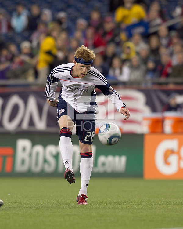 New England Revolution midfielder Pat Phelan (28) takes a shot. In a Major League Soccer (MLS) match, the New England Revolution tied the Portland Timbers, 1-1, at Gillette Stadium on April 2, 2011.