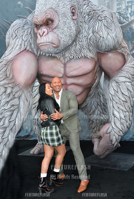 Dwayne Johnson &amp; Simone Johnson at the premiere for &quot;Rampage&quot; at the Microsoft Theatre, Los Angeles, USA 04 April 2018<br /> Picture: Paul Smith/Featureflash/SilverHub 0208 004 5359 sales@silverhubmedia.com