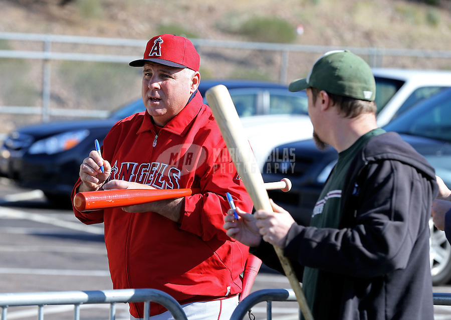 Feb. 12, 2013; Tempe, AZ, USA: Los Angeles Angels manager Mike Scioscia signs autographs for fans during spring training at Tempe Diablo Stadium. Mandatory Credit: Mark J. Rebilas-USA TODAY Sports
