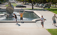 Occidental College students keep the long tradition going of throwing friends into the Gilman Fountain on their birthdays, Sept. 28, 2010. (Photo by Marc Campos, Occidental College Photographer)