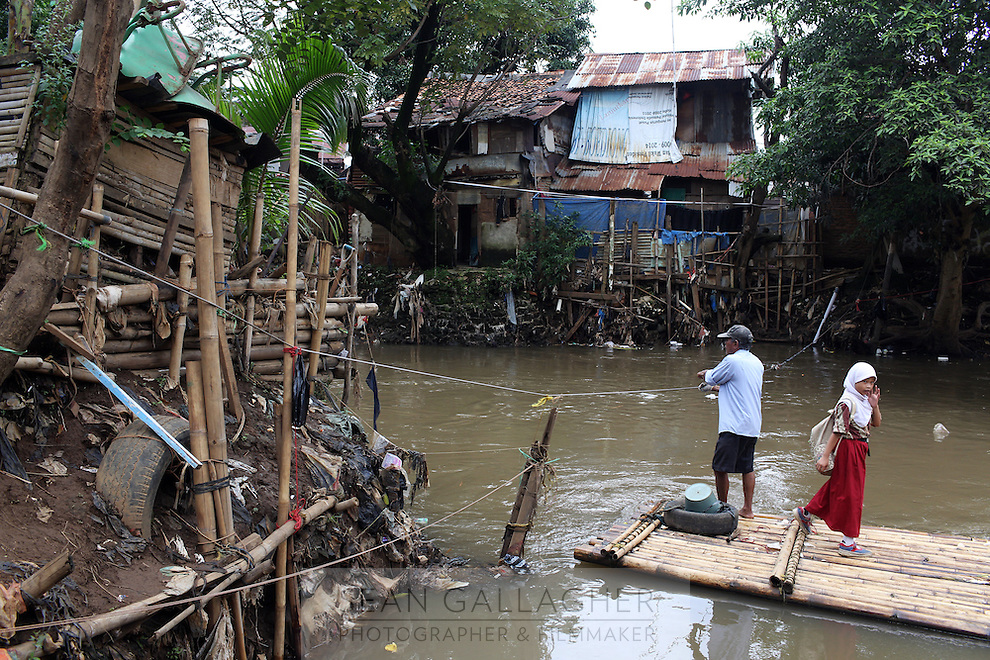 A boat that takes residents across a river in a slum community in central Jakarta. Many of the city's poorest residents live just inches above the waterline throughout the city.