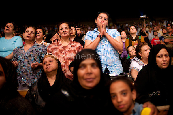 Copts and Muslims next to each others during the Thursday evening sermon in St Simeon Church until Father Samaan begins his exorcism.<br />