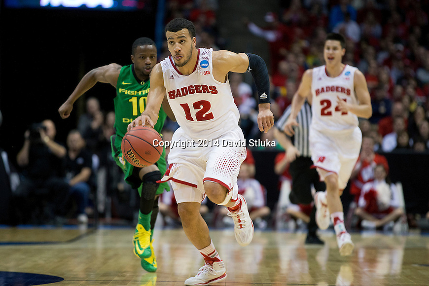 Wisconsin Badgers guard Traevon Jackson (12) leads a fast break during the third-round game in the NCAA college basketball tournament against the Oregon Ducks Saturday, April 22, 2014 in Milwaukee. The Badgers won 85-77. (Photo by David Stluka)
