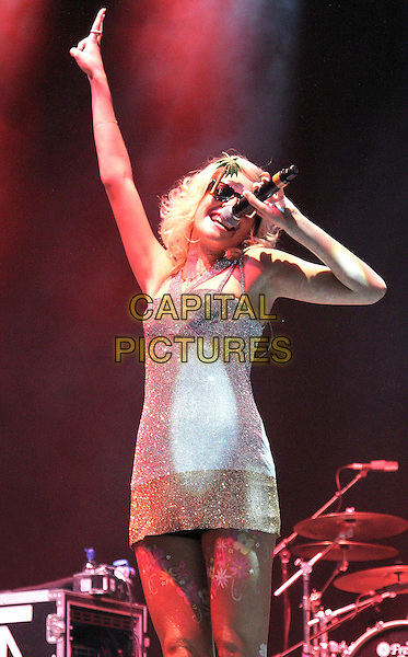 Pixie Lott (Victoria Louise Lott).V Festival 2012 - Day Two, Hylands Park, Chelmsford, Essex, England..August 19th 2012.on stage in concert live gig performance music half length white gold silver dress hand arm in air sunglasses shades  singing.CAP/JIL.©Jill Mayhew/Capital Pictures