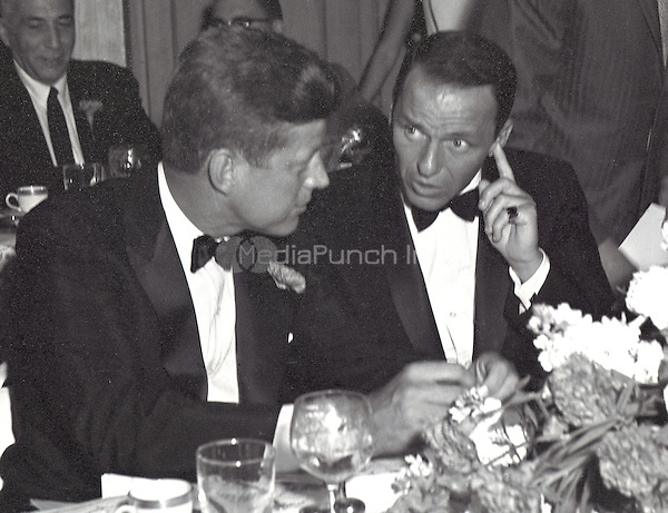 United States Senator John F. Kennedy (Democrat of Massachusetts), left, and entertainer Frank Sinatra, right, at the black tie Democratic Committee Dinner at the Beverly Hilton Hotel in Los Angeles, California on Sunday, July 10, 1960.<br /> Credit: Benjamin E. &quot;Gene&quot; Forte / CNP/MediaPunch