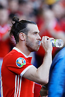 Gareth Bale drinks water as he exits the tunnel during the UEFA EURO 2020 Qualifier match between Wales and Slovakia at the Cardiff City Stadium, Cardiff, Wales, UK. Sunday 24 March 2019