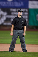 2B umpire Phil Bando at Lindquist Field on September 14, 2017 in Ogden, Utah. The Ogden Raptors defeated the Great Falls Voyagers 7-4 in Game One of the Pioneer League Championship. (Stephen Smith/Four Seam Images)