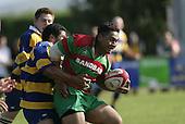 S. Kata tries to break out of the tackle of Fehoko. Counties Manukau Premier Club Rugby, Waiuku vs Patumahoe played at Rugby Park, Waiuku on the 8th of April 2006. Waiuku won 18 - 15