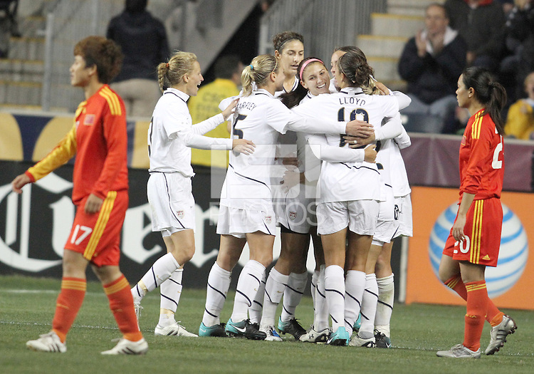Alex Morgan #21 of the USA WNT is conratulated after scoring the tying goal during an international friendly match against the PRC WNT at PPL Park, on October 6 2010 in Chester, PA. The game ended in a 1-1 tie.