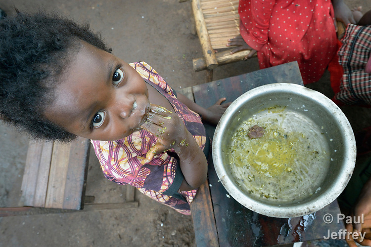 Two-year old Jennifer Angel enjoys the last of her family's meal in a camp for more than 5,000 displaced people in Riimenze, in South Sudan's Gbudwe State, what was formerly Western Equatoria. Families here were displaced at the beginning of 2017, as fighting between government soldiers and rebels escalated.<br />