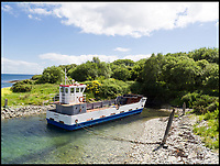 BNPS.co.uk (01202 558833)<br /> Pic:  Strutt&Parker/BNPS<br /> <br /> Livestock and machinery are transported between Inchmarnock and Bute by a ferry, The Marnock, which is docked on the island.<br /> <br /> A stunning Scottish island has emerged for sale for just £1.4million - the cost of a London terraced home.<br /> <br /> Inchmarnock, at the northern end of the Sound of Bute in the Firth of Clyde, is 2.5 miles long, half a mile wide and has 4.75miles of coastline.<br /> <br /> The 660 acre island has a fascinating history, having been a target of Viking raids and used as a D-Day training ground - with bomb craters still visible in its landscape.<br /> <br /> A farmer even discovered the remains of a local Bronze Age woman, the Queen of the Inch, on the island in the 1960s. She lay in a stone cist wearing a black lignite necklace and carrying a flint dagger.