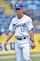 Asheville Tourists manager Warren Schaeffer (13) after being ejected by first base umpire Jason Johnson before a game against the Charleston RiverDogs at McCormick Field on July 10, 2016 in Asheville, North Carolina. The Tourists defeated the RiverDogs 4-2. (Tony Farlow/Four Seam Images)