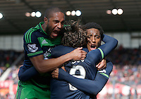 Swansea City's Alberto Paloschi celebrates his equalising goal with Leroy Fer and  Ashley Williams during the Barclays Premier League match between Stoke City and Swansea City played at Britannia Stadium, Stoke on April 2nd 2016