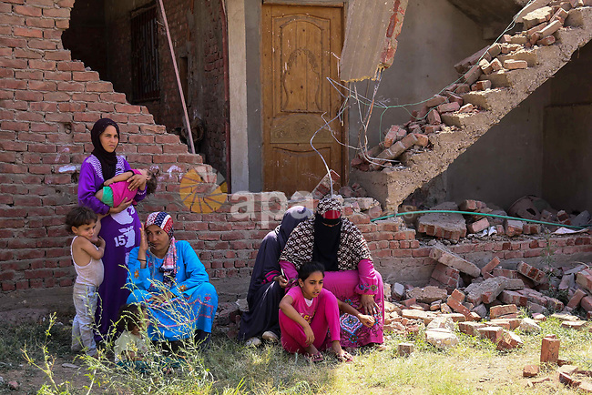Egyptians look during the operations of removal of illegal buildings which built on the state lands  in the Warraq district of Giza, southwest of Cairo, Egypt, on July 16, 2017. Photo by Amr Sayed