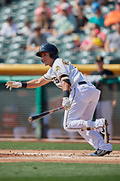 Michael Hermosillo (9) of the Salt Lake Bees bats against the Fresno Grizzlies at Smith's Ballpark on September 4, 2017 in Salt Lake City, Utah. Fresno defeated Salt Lake 9-7. (Stephen Smith/Four Seam Images)