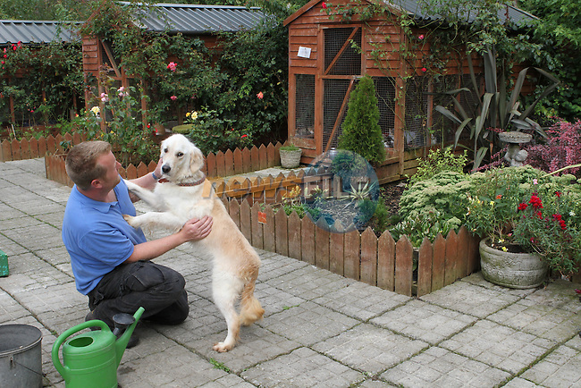 Kevin Cunningham with Molly the Golden Retriever at Collon Animal Santuary...Photo NEWSFILE/Jenny Matthews.