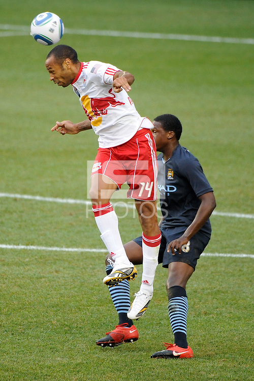 Thierry Henry (14) of the New York Red Bulls heads the ball over Dedryck Boyata (38) of Manchester City F. C. during a Barclays New York Challenge match at Red Bull Arena in Harrison, NJ, on July 25, 2010.
