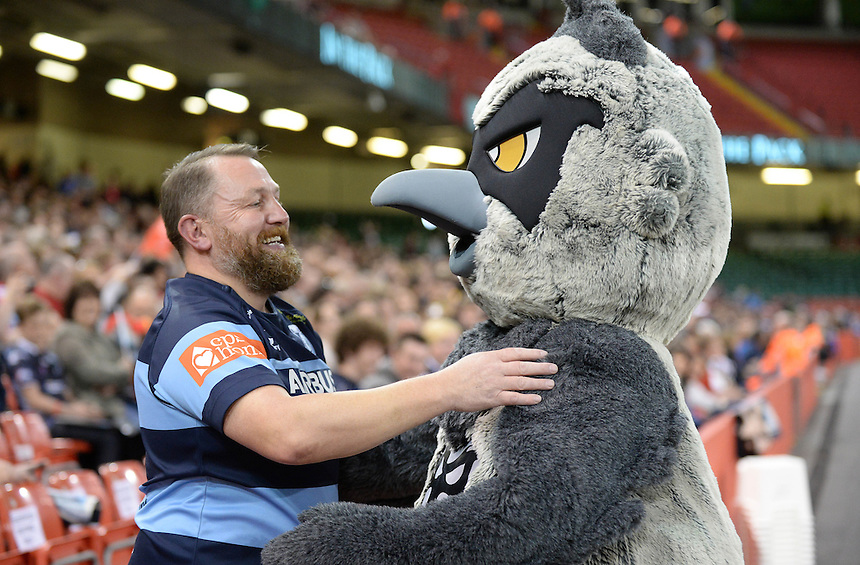 Ospreys mascot Ozzie the Osprey embraces with a Cardiff Blues fan <br /> <br /> Photographer Ian Cook/CameraSport<br /> <br /> Rugby Union - Guinness PRO12 - Saturday 25th April 2015 - Cardiff Blues v Ospreys - Millennium Stadium - Cardiff<br /> <br /> &copy; CameraSport - 43 Linden Ave. Countesthorpe. Leicester. England. LE8 5PG - Tel: +44 (0) 116 277 4147 - admin@camerasport.com - www.camerasport.com