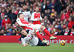 Arsenal's Mesut Ozil gets fouled by Tottenham's Kevin Wimmer during the Premier League match at the Emirates Stadium, London. Picture date November 6th, 2016 Pic David Klein/Sportimage